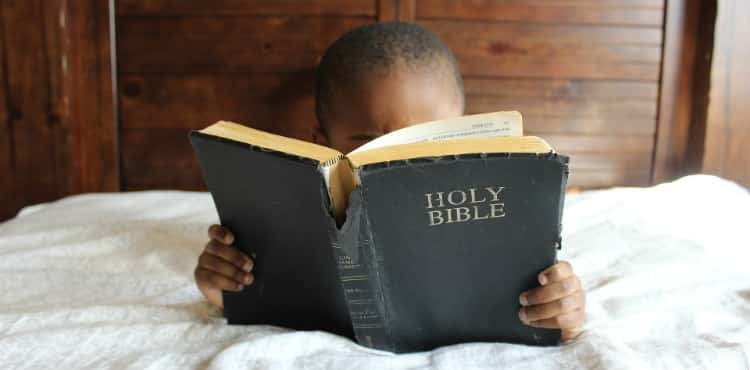 Young Boy Reads Bible